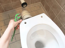Plumber and toilet bowl Stock Photos