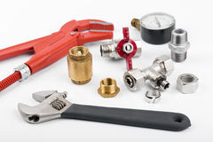 Plumber tools and accessories on white Stock Photo