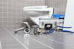 Plumber tools and equipment in a bathroom, plumbing repair service, assemble and install concept stock images