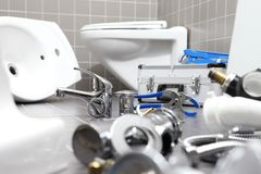Plumber tools and equipment in a bathroom, plumbing repair service, assemble and install concept stock photo
