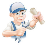 Plumber Training. Plumber or mechanic with certificate, qualification or other scroll and wrench. Education concept for being professionally qualified or Royalty Free Stock Photography