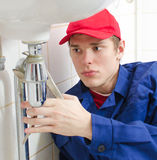 Plumber in uniform Stock Photography