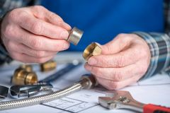 Plumber using plumbing fittings Royalty Free Stock Images