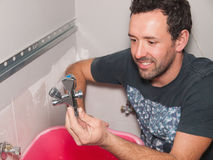 Plumber with a valve in his hand Stock Photos