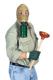 Plumber wearing gas mask. A plumber wears his gas mask as he prepares to unclug a toilet Royalty Free Stock Photo