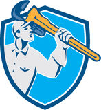 Plumber Wielding Monkey Wrench Shield Retro Stock Photography
