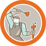 Plumber Wielding Plunger Wrench Circle Cartoon. Illustration of a plumber wielding plunger and holding monkey wrench set inside circle on isolated background Royalty Free Stock Photos