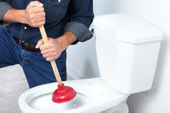 Free Plumber With A Plunger Stock Images - 17312924
