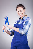 Plumber woman with wrench Royalty Free Stock Image