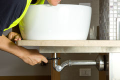 Plumber at work Stock Photography
