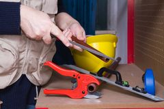 Plumber at work in his workshop Royalty Free Stock Images