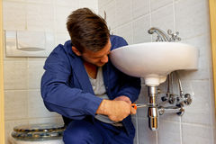 Plumber at work Stock Image