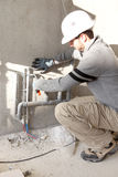 Plumber at work outdoors Stock Image