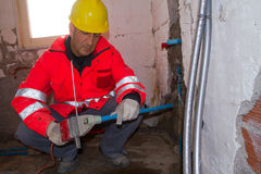 Plumber at work in a site Royalty Free Stock Images