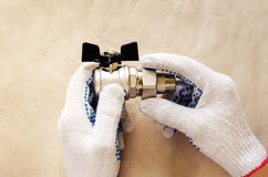 Plumber at work with tools plumbing Stock Photos