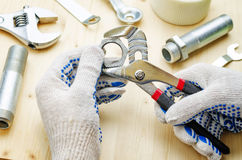 Plumber at work with tools plumbing Stock Photo