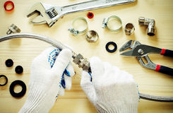 Plumber at work with tools plumbing Stock Images