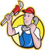 Plumber Worker With Adjustable Wrench Phone. Cartoon illustration of a plumber worker repairman tradesman with adjustable monkey wrench talking on telephone Royalty Free Stock Photography