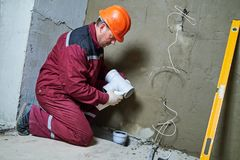 Plumber worker installing sewage pipes in sewerage system Stock Image