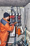 Repair of hydraulic heating system in the house. Plumber worker repairs the heating system in the house royalty free stock photography