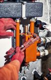 Repair of hydraulic heating system in the house. Plumber worker repairs the heating system in the house stock images