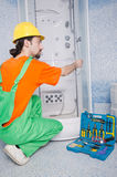 Plumber working in the bathroom. With tools Stock Photos