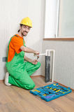 Plumber working in  bathroom Stock Image