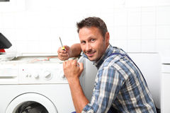 Plumber working on domestic appliance