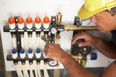 Plumber Working On Pipework Stock Photography