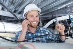 Plumber working on roof Royalty Free Stock Photography
