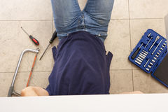 Plumber Working On Sink Stock Photos