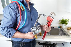Plumber with a wrench. Royalty Free Stock Images