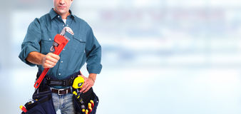 Plumber with wrench. stock images