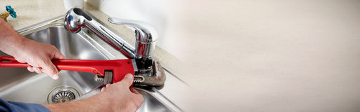 Plumber with wrench. royalty free stock photos