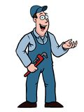 Plumber with wrench showing something. Plumber in overall with a wrench showing something Stock Image
