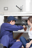 Plumbers couple reviewing the washing Stock Image