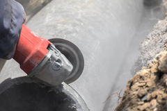 Plumbers cutting concrete water pipes Stock Image
