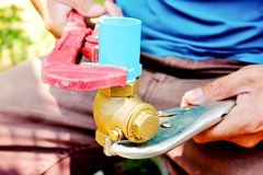 Plumbers repair water pipes Royalty Free Stock Photos