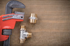 Plumbers wrench brass connector fittings on cleaning mesh filter Royalty Free Stock Photos