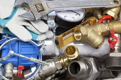 Plumbing. Various plumbing and  heating system accessories and parts Stock Photography