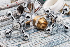 Plumbing and accessories. On wooden table Royalty Free Stock Photo