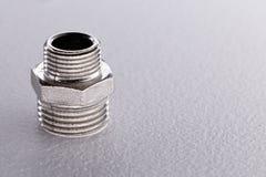 Plumbing adapter on white background Stock Photos