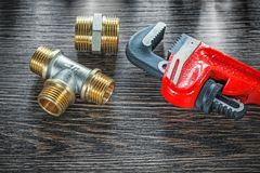 Plumbing adjustable wrench pipe connectors on vintage wooden boa. Rd Stock Photos