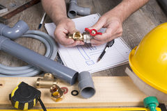 Plumbing do-it-yourself with different tools Royalty Free Stock Photo