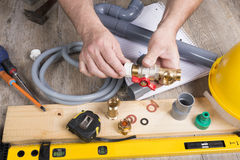 Plumbing do-it-yourself with different tools Stock Photos