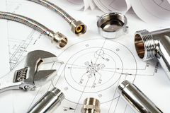 Plumbing and drawings, construction still life Royalty Free Stock Images