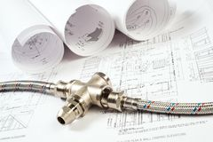 Plumbing and drawings, construction still life Stock Images