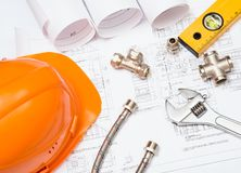 Plumbing and drawings, construction still life Stock Photo