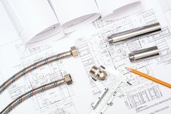 Plumbing and drawings, construction still life Royalty Free Stock Image