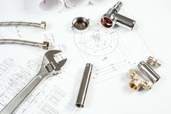 Plumbing and drawings, construction still life Stock Image